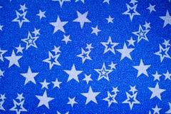 White stars on blue shiny background stock image