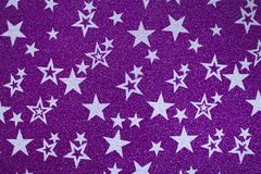 White stars on purple shiny background royalty free stock image