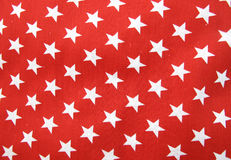 White stars on red cloth material Royalty Free Stock Photos