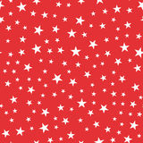 White stars seamless pattern on red background. Royalty Free Stock Image