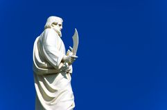 White statue. A religious white statue of a man with knife Stock Photo