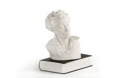 White statue on the book Royalty Free Stock Photography