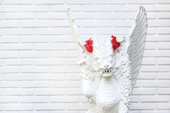 White statue with hibiscus flower Royalty Free Stock Image