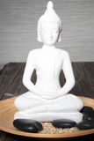 White statue of a meditating buddha Royalty Free Stock Photo