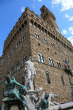 White statue of Neptune in the ancient fountain in Florence and Stock Image