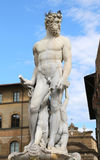 White statue of Neptune in the ancient fountain in Florence Stock Images