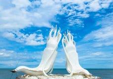 White statue squid and sea at Cha am Beach in Petchabur. stock photo