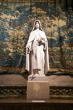 White statue with tapestry Royalty Free Stock Photos