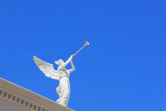 A white statue of a winged troubadour Stock Images