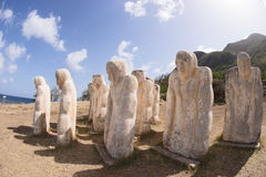 White statues on a sea side at Martinique. Martinique, slave memorial in Le Diamant in West Indies Royalty Free Stock Photos