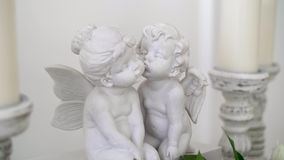 White statues of two kissing angels. The Big Day. Antique statue of angels.  stock footage