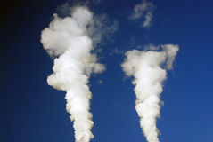 White steam. Blue sky background. Royalty Free Stock Photography