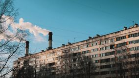 White steam coming out pipes in town dormitory area on winter sunny day stock footage