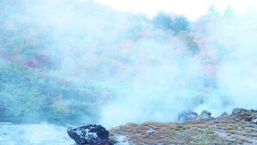White steam flow from the ground in Tamagawa Hot Spring