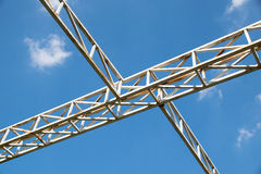 White steel cross structure on blue sky Stock Photography