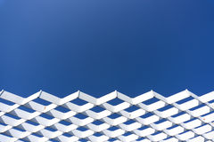 White steel mesh structure with blue sky background. Background from architecture and nature Royalty Free Stock Photos