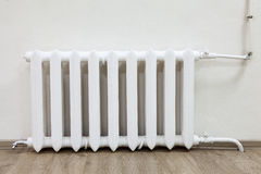 White steel radiator of central heating in room Royalty Free Stock Image