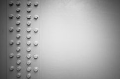 White steel wall with bolts, metal details Royalty Free Stock Photo
