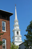 White steeple of church against blue sky, downtown Keene, New Ha Royalty Free Stock Photos