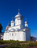 White steeple church with three domes Stock Images