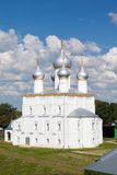 White steeple church with three domes Royalty Free Stock Image