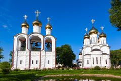 White steeple church with three domes Royalty Free Stock Photos