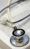 White stethoscope on a medical book. Shallow depth of field stock photo