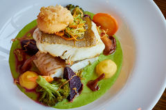 White stewed pikeperch fish in green pesto sauce with vegetables for steaming broccoli, carrots, beets, mushrooms, mashed potatoes Stock Photography