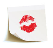 White sticker with the imprint kiss Royalty Free Stock Images