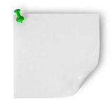 White sticker with the wrapped up corner pinned green office pin Royalty Free Stock Images