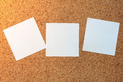 White sticky notes. On a cork board Royalty Free Stock Photo