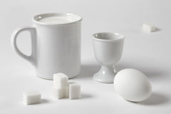 White still life with a mug and an egg royalty free stock image