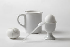 White still life with a mug and an egg Royalty Free Stock Photos