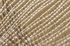 White stitches pattern. Close up of industrial embroidered white stitches on green textile Stock Image