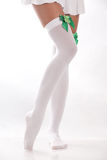 White stockings with shamrocks. A woman wearing a pair of white stockings with green shamrocks stock photos
