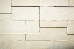 White stone brick wall. Pattern of white modern stone brick wall surfaced Stock Photography
