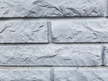 White Stone Brick Wall on the outside of a building. A white stone brick wall texture found on a building in an old part of town Royalty Free Stock Photo