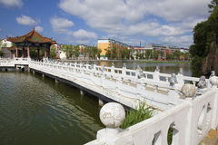 White stone bridge on lake Royalty Free Stock Image