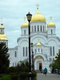 White Stone Cathedral on the green alley royalty free stock photo