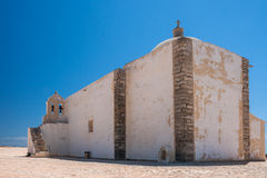 White stone chapel at Fortaleza de Sagres in Portugal. Church of Our Lady of Grace at Sagres Fortress Stock Image