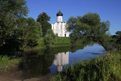 He white stone Church of the Intercession of the Most Holy Mother of God on Nerli the 12th century located on a meadow near stock images