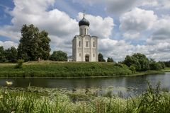White stone Church of the Intercession on the Nerl with reflection in the water summer day Russia stock image