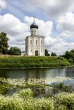 White stone Church of the Intercession on the Nerl with reflection in the water summer day Russia royalty free stock image