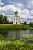White stone Church of the Intercession on the Nerl with reflection in the water summer day Russia stock photos