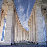 White stone columns against the sky. The Colonnade in Rome Royalty Free Stock Photography