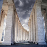White stone columns against the sky. The Colonnade in Rome Stock Photo
