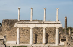 White Stone Columns in Pompeii. Double row of white stone columns in the ancient lost city of Pompeii royalty free stock photo