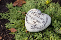 White stone heart with german text on the tomb. Royalty Free Stock Photos