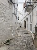Narrow street in old city of Ostuni, Italy royalty free stock images