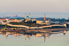The white-stone Kazan Kremlin at sunset. Wall lit by the sun and reflected in the water. Royalty Free Stock Photos